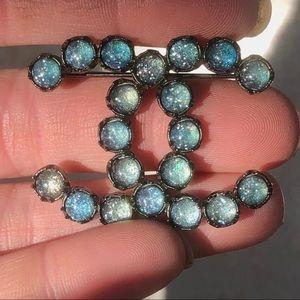 Gunmetal & iridescent blue galaxy CC brooch
